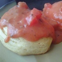 Mama's Tomato Gravy Recipe - This dish is truly a taste of Louisiana Cajun Country. My mama made countless batches of biscuits and tomato gravy in her lifetime. I'm sure she learned to make this from her mother. This is the dish that puts my feet back under my mama's table. Serve with love over hot buttermilk biscuits along with bacon or sausage for breakfast, brunch, lunch or dinner.