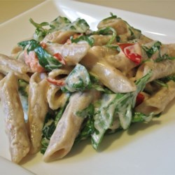 Goat Cheese and Arugula over Penne Recipe - For an absolutely fresh-from-the-garden delight, combine goat cheese with arugula, cherry tomatoes, olive oil, garlic, salt and pepper, and toss with hot penne pasta.