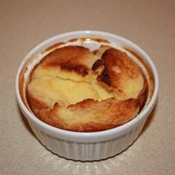 English Bread and Butter Pudding Recipe - Bread is soaked in milk then combined with butter, brown sugar, mixed spice, dried fruit, an egg and orange zest, sprinkled with nutmeg and slowly baked until set.
