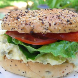 World's Best Egg Salad Sandwich Recipe - This spunky egg salad is seasoned with hot jalapenos, garlic, and honey mustard.  Fresh tomatoes and baby spinach add beautiful color and great flavor.