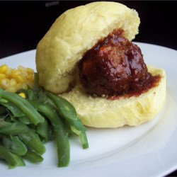 BBQ Glazed Homemade Meatballs Recipe - Homemade meatballs made from beef, onion, oatmeal, evaporated milk, and egg, and glazed with a homemade barbecue sauce made with ketchup, brown sugar, garlic, and liquid smoke. Best meatballs I ever tasted. Everyone asks for this recipe.