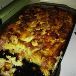 French Ham Cheese and Egg Fondue Casserole Recipe - This delicate dish is loaded with ham, cheese and bread cubes in an egg mixture is perfect for brunch or supper. Goes great with some fresh fruit and blueberry muffins! Another plus is you make it day ahead, so you have more time out of the kitchen!