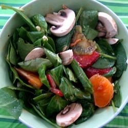 Springtime Spinach Salad Recipe - Strawberries and spinach are delicious in the Spring, and tossed with other fresh ingredients, real bacon, and hard cooked eggs, they make a wonderful salad. A sweet, tangy oil and vinegar dressing tops it off!