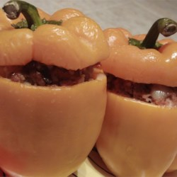 Sammy's Stuffed Bell Peppers Recipe - Bell peppers are stuffed with a simple mixture of beef, rice, and onion, then baked until tender. Leftover filling can be used to make a quick pasta sauce, or served with hamburger buns as a sloppy joe alternative.