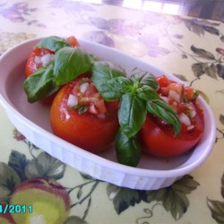Deviled Tomatoes Recipe - Tomatoes are hollowed out and the pulp is mixed with a simple vinaigrette.  Serve as a light first course or a super side dish for grilled meat or fish.