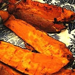 Grilled Chipotle Sweet Potatoes Recipe - Sweet potatoes aren't just for Thanksgiving. When coated in a sweet and spicy sauce and grilled until tender, they make a fabulous summer side dish.