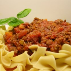 Slow Cooker Bolognese Recipe - The slow cooker takes the work and mess out of simmering an Italian-inspired Bolognese meat sauce that's perfect for ladling over a plate of hot pasta.