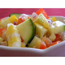 Kristi's Corn Salad Recipe - Corn, zucchini, onions, pimentos, and green chiles are coated with a zesty oil and vinegar dressing. This chilled salad is great for cookouts!