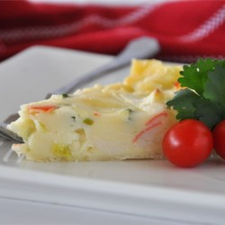 Crab Quiche I Recipe - This is an easy seafood quiche.  A wonderful brunch recipe, or can also be a good main course for a light dinner. Crab, Swiss cheese and onion combined with eggs milk and flour, then baked in a pie crust.