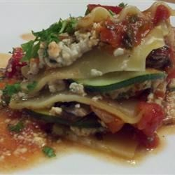 Vegan Lasagna I Recipe - A thick tomato-based sauce is cooked up with hints of garlic, onion, parsley, and basil, and layered with a tofu and spinach filling.