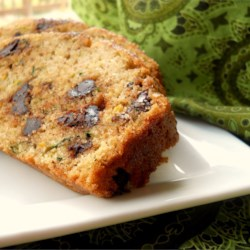 Chocolate Chip Orange Zucchini Bread Recipe - For these two loaves of heavenly quick bread, the flavors and textures of orange, zucchini, chocolate and chopped nuts are marvelously combined.