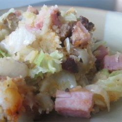 Bubble 'n' Squeak Recipe - Cabbage, bacon, ham, onion and leftover potatoes make up this tasty, easy dish. This is a great way to get the kids to eat cabbage. Using leftovers makes this main dish especially quick to make. I recommend using a good nonstick pan. Serve with ketchup, if desired.