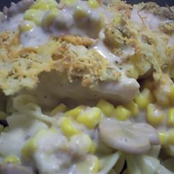 Creamy Garlic Mushroom Chicken Recipe -  Canned mushroom garlic soup is jazzed up with sour cream, corn and parmesan to coat baked chicken breasts.