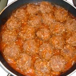 "Melinda's Porcupine Meatballs  Recipe - These easy meatballs are simmered in a simple tomato sauce. Your kids will love the little ""spikes"" made of rice."