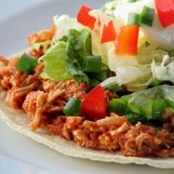 Mexican Tinga Recipe - This is an authentic Mexican favorite! Shredded chicken and onions are simmered in a thick and spicy chipotle sauce, then served over crunchy tostada shells.
