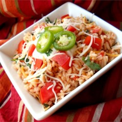 Mexican Rice III Recipe and Video - This is an excellent authentic Mexican rice recipe (not to be confused with Spanish rice) that I make as a side dish with all of my Mexican dishes. The key is cooking the rice properly and using good quality chicken broth or stock.