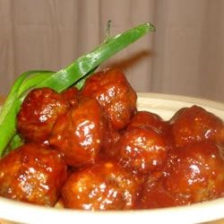 Cocktail Meatballs III Recipe - In this easy appetizer, much of the flavor comes from the meatballs rather than the accompanying piquant sauce -they 're enriched with real cream and savory onion-soup mix.