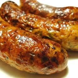 Beer Brats Recipe - Bratwursts are simmered in a mixture of beer, onions, and seasonings, and then finished on the grill!