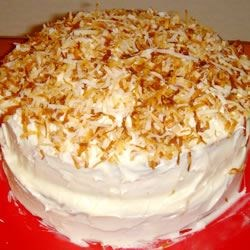 Coconut Cake III Recipe - A delicious coconut cake made from a cake mix with coconut cream cheese frosting and garnished with toasted coconut.