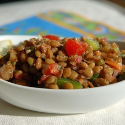 Refreshing Lentil Salad Recipe - This colorful lentil salad, packed with olives and vegetables and garnished with hard-cooked eggs, gets tangy flavor from cilantro, garlic, and fresh chile pepper.