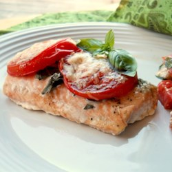 Tomato Basil Salmon Recipe - This quick salmon dish is perfect for a weeknight dinner. Serve with a side of sauteed spinach and a glass of pinot noir.