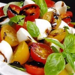 Insalata Caprese I Recipe - Thick wedges of ripe tomatoes, fresh Mozzarella and slices of red onion are tossed in olive oil and vinegar and sprinkled with chopped, fresh basil. Chill and eat.
