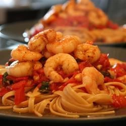 Linguine Pasta with Shrimp and Tomatoes Recipe - A sauce made from fresh tomatoes is the secret ingredient in this delicious shrimp pasta.