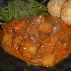 French Beef Stew Recipe - Thyme and Dijon mustard make this a tangy stew. It is made with plenty of vegetables -  carrots, potatoes, and tomatoes.