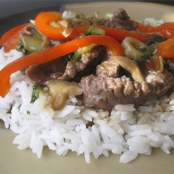 Japanese Beef Stir-Fry Recipe - Tender beef strips are quickly stir-fried with crisp and colorful vegetables to make this delicious restaurant-style dinner in your own kitchen.