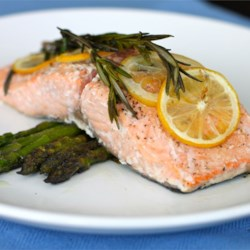 Lemon Rosemary Salmon Recipe - Salmon fillets are baked with lemon, rosemary, olive oil, and coarse salt in this simple preparation for an impressive romantic meal!