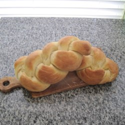 Easy Challah Bread Recipe - This traditional braided challah bread has eggs, a hint of honey, and a golden brown egg-wash crust, but it only needs a few pantry basics.