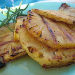 Grilled Pineapple Recipe - These are SO easy and really good. The hot sauce gives it an extra kick and cuts the sweetness. They can help with patience while the rest of the grilled feast comes together, but be warned, they go quickly!