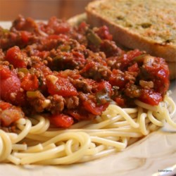 Lots O'Veggies Sausage Spaghetti Sauce Recipe - Italian sausage and ground beef are simmered with tomatoes, onion, bell pepper, zucchini, mushrooms, carrots and garlic and herbed with basil, oregano and thyme in this slowly cooked rich sauce.