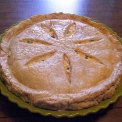 Chicken Pot Pie VI Recipe - This pie is hearty, wonderfully flavorful and bursting with mozzarella and Cheddar cheeses. Along with the cheese, there 's cream of mushroom and cream of chicken soups, chicken, veggies, and mushrooms.