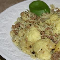 Upside Down Recipe - This hearty dish from the Middle East combines rice with roasted cauliflower. Ground beef is optional; make it vegetarian if you prefer. Once the dish is cooked, it's flipped over onto a serving platter to serve.