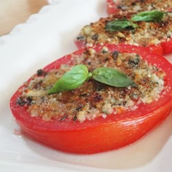 Baked Tomatoes Oregano Recipe - Ripe tomatoes are baked with Romano cheese, fresh bread crumbs, garlic and herbs.