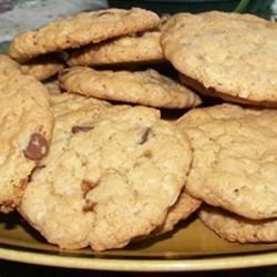 Crisp Oatmeal Cookies Recipe - Use this recipe with coconut, oatmeal, and chocolate chips to make crispy, delicious oatmeal cookies.