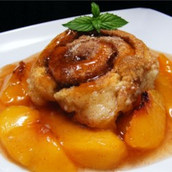 Peach Whirligigs Recipe - Cinnamon rolls baked in a fresh peach sauce -- switch to apples in winter!