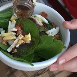 Fresh Spinach Salad Recipe - Crisp fresh spinach is tossed with melt-in-your-mouth crumbled bacon, diced hard-boiled eggs and crunchy water chestnuts and drizzled with a sweet and tangy homemade dressing.