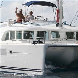 Joe & Carol on their crewed charter catamaran in the BVI