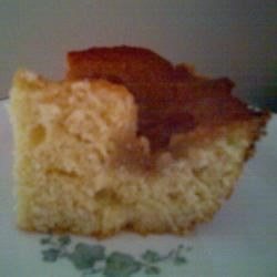 Honey Comb Coffee Cake Recipe - Great ingredients in this coffe cake: almond and orange extracts, butter, pecans, honey and nutmeg....moist and delicious!  It is easy to make. Just mix up the cake, boil and pour on the topping, and bake.