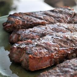 Barbequed Steak Recipe - A tender cut like Porterhouse, T-Bone, Rib Eye, New York or Top Sirloin are all good steaks for this simple marinade. Serve with a dollop of garlic butter, if desired.