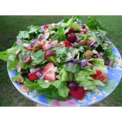Strawberry Salad Recipe - Romaine lettuce and cabbage are the base of this salad fruit and nuts and dressed with creamy poppy seed dressing.