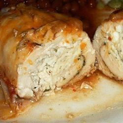 Cream Cheese, Garlic, and Chive Stuffed Chicken Recipe - Butterflied chicken breasts are stuffed with a garlic, chive, and cream cheese mixture, wrapped with a slice of bacon, and topped with butter. Very delicious and easy to make!