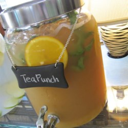 Tea Punch Recipe - A different twist to a standard punch. Brewed tea is mixed with orange juice, pineapple juice, lemonade and ginger ale.