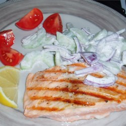 Grilled Salmon With Cucumber Salad Recipe - Cucumber salad perfectly accompanies a piece of grilled salmon.