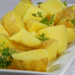 Boiled Mustard Potatoes Recipe - Potatoes simmer with yellow mustard until they are yellow, tender, and infused with mustard flavor. It couldn't be a simpler way to add flavor to your most basic side dish.