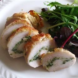 Pesto Cheesy Chicken Rolls Recipe - Boneless, skinless chicken breasts are baked with pesto sauce and mozzarella cheese for an easy family-pleasing dinner.