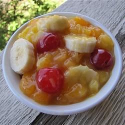 Momma Lamb's Famous Fruit Salad Recipe -  Pineapple juice is stirred into vanilla pudding mix and then the fruit  - pineapple chunks, cherries and mandarin oranges - are stirred into that. Chill and serve with sliced bananas.