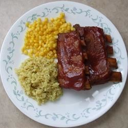 Oven Ribs Recipe - Pork spareribs are browned, then roasted in a rich red sauce until fork tender. An easy recipe that yields delicious results.